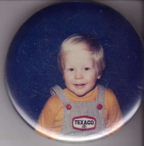 smiling blonde boy in overalls