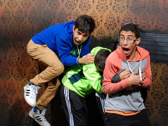 scared people at a haunted house