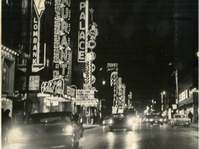 a nighttime scene in downtown Montreal of the 1950s