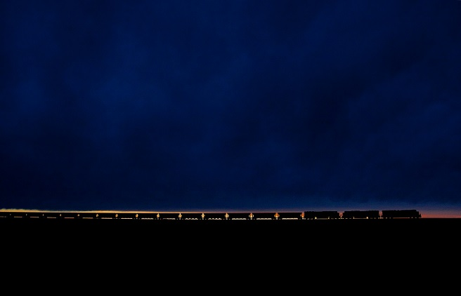 a long train against the horizon at nightfall